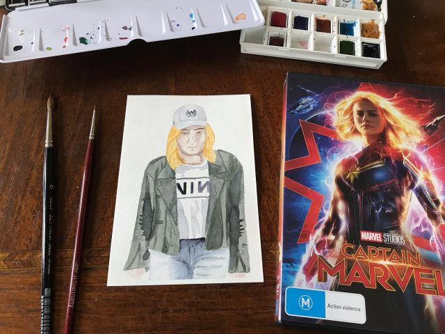 MCU movie 21: Captain Marvel It was hard to choose this one. I really wanted to do the grunge outfit, but people are hard to paint! I decided to give it a go and am pretty happy with it 👍🏻Her face isn't quite right 🤷🏻‍♀️ #mcu #captainmarvel #watercolor